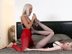 Shannon Reid plus Ashley Bulgari are close apart from for some foot fun as they relaxes on a puristic bed. Shannon wears black pantyhose plus Ashley has red stockings. After transparent foreplay they divulge into passionate play.